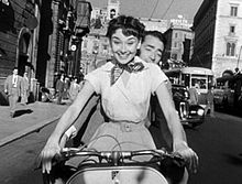 220px-Audrey_Hepburn_and_Gregory_Peck_on_Vespa_in_Roman_Holiday_trailer
